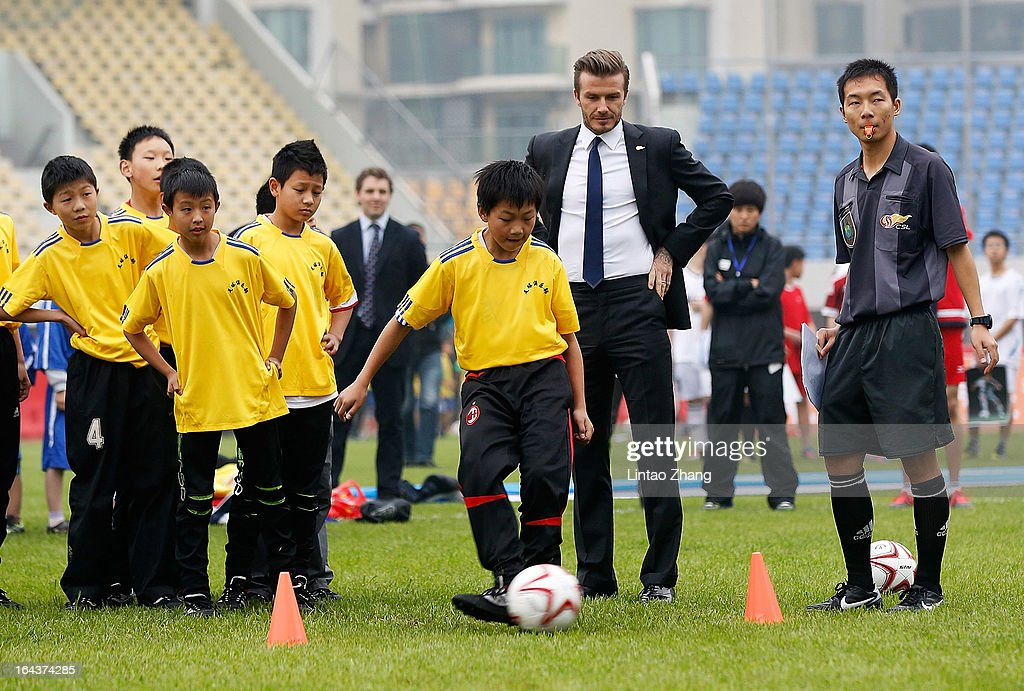 British football player David Beckham attends meeting with the Youth Football Team at Hankou Literary and Sports Centeron March 23, 2013 in Wuhan, China. David Beckham is on a five-day visit to China at the invitation of the China Football Association as China's first international ambassador.