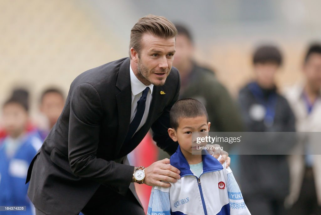 British football player <a gi-track='captionPersonalityLinkClicked' href=/galleries/search?phrase=David+Beckham&family=editorial&specificpeople=158480 ng-click='$event.stopPropagation()'>David Beckham</a> attends meeting with the Youth Football Team at Hankou Literary and Sports Centeron March 23, 2013 in Wuhan, China. <a gi-track='captionPersonalityLinkClicked' href=/galleries/search?phrase=David+Beckham&family=editorial&specificpeople=158480 ng-click='$event.stopPropagation()'>David Beckham</a> is on a five-day visit to China at the invitation of the China Football Association as China's first international ambassador.