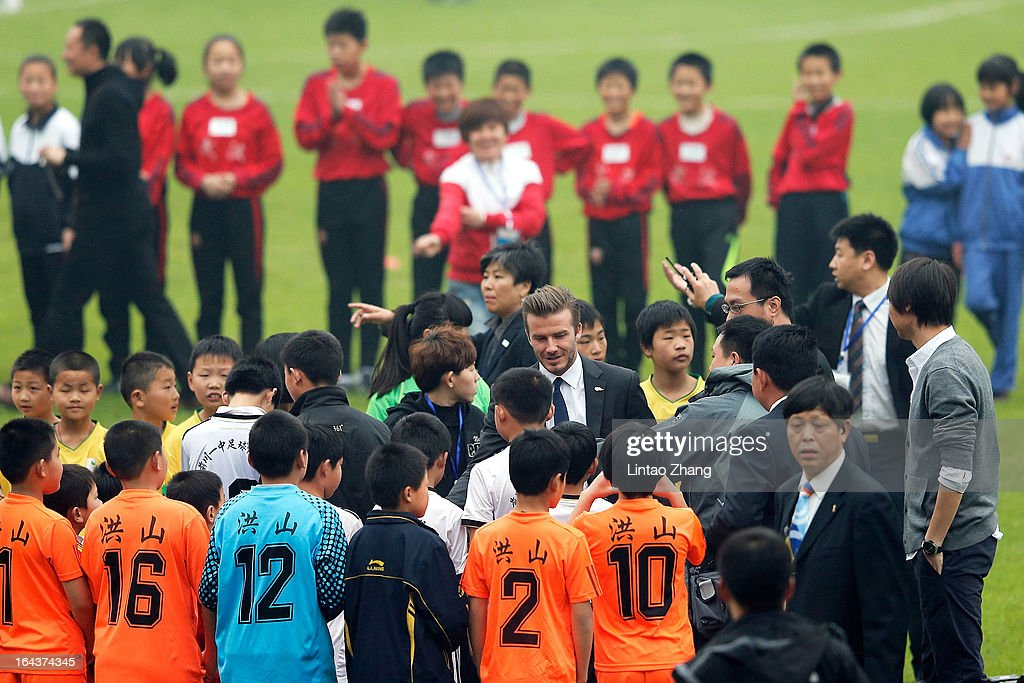 British football player David Beckham (Center) attends meeting with the Youth Football Team at Hankou Literary and Sports Centeron March 23, 2013 in Wuhan, China. David Beckham is on a five-day visit to China at the invitation of the China Football Association as China's first international ambassador.