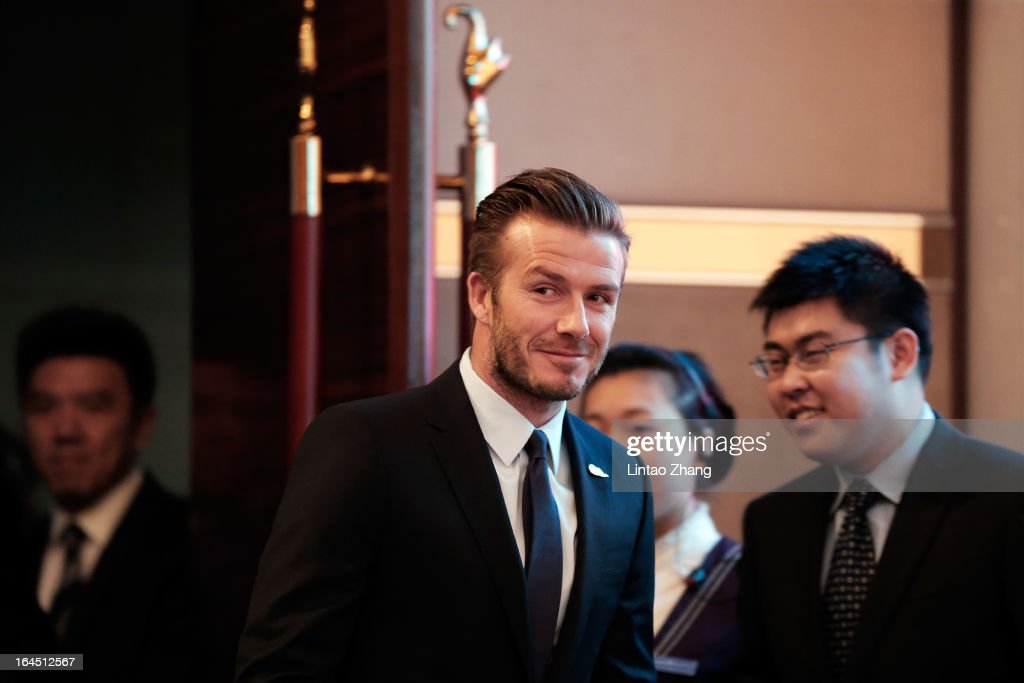 British football player David Beckham attends meets fans at China World Trade Center Tower 3 on March 24, 2013 in Beijing, China. David Beckham is on a five-day visit to China at the invitation of the China Football Association as China's first international ambassador.