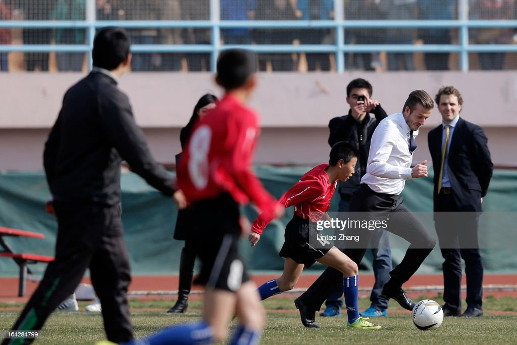 British football player <a gi-track='captionPersonalityLinkClicked' href=/galleries/search?phrase=David+Beckham&family=editorial&specificpeople=158480 ng-click='$event.stopPropagation()'>David Beckham</a> <a gi-track='captionPersonalityLinkClicked' href=/galleries/search?phrase=David+Beckham&family=editorial&specificpeople=158480 ng-click='$event.stopPropagation()'>David Beckham</a> plays football with the Qingdao youth team at Tiantai Stadium, Shandong Province on March 22, 2013 in Qingdao, China. <a gi-track='captionPersonalityLinkClicked' href=/galleries/search?phrase=David+Beckham&family=editorial&specificpeople=158480 ng-click='$event.stopPropagation()'>David Beckham</a> is on a five-day visit to China at the invitation of the China Football Association as China's first international ambassador.