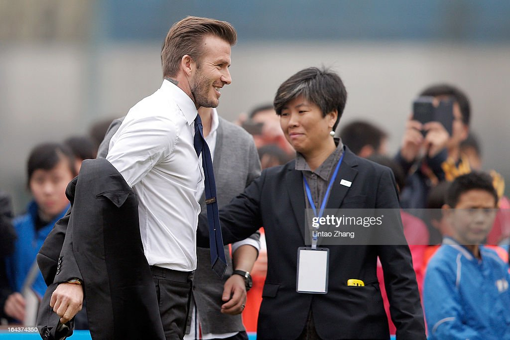 British football player David Beckham David Beckham prepares to play football with the youth team at Hankou Literary and Sports Centeron March 23, 2013 in Wuhan, China. David Beckham is on a five-day visit to China at the invitation of the China Football Association as China's first international ambassador.