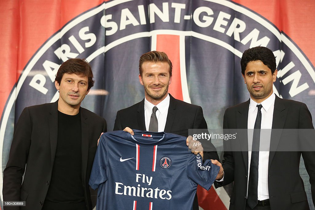British football player David Beckham (C), flanked by PSG Qatari president Nasser Al-Khelaifi (L) and Brazilian sport director Leonardo, poses with his new jersey at the end of a press conference, on January 31, 2013 at the Parc des Princes stadium in Paris. Beckham signed a five-month deal with the Ligue 1 leader until the end of June.