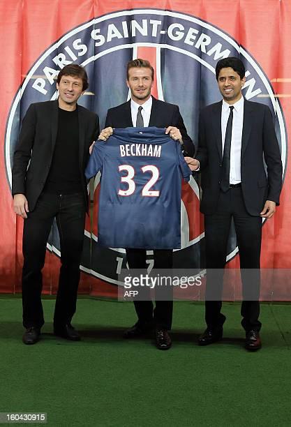 British football player David Beckham flanked by PSG Qatari president Nasser AlKhelaifi and Brazilian sport director Leonardo poses with his new...