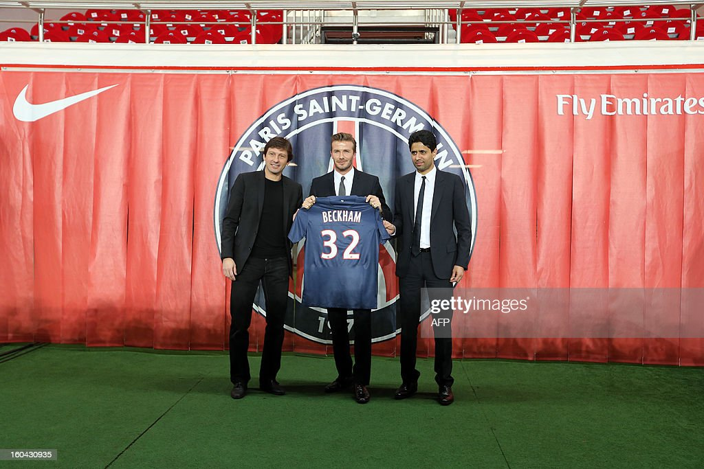 British football player David Beckham (C), flanked by PSG Qatari president Nasser Al-Khelaifi (L) and Brazilian sport director Leonardo, poses with his new Paris Saint-Germain (PSG) jersey at the end of a press conference, on January 31, 2013 at the Parc des Princes stadium in Paris. Beckham signed a five-month deal with the Ligue 1 leader until the end of June.