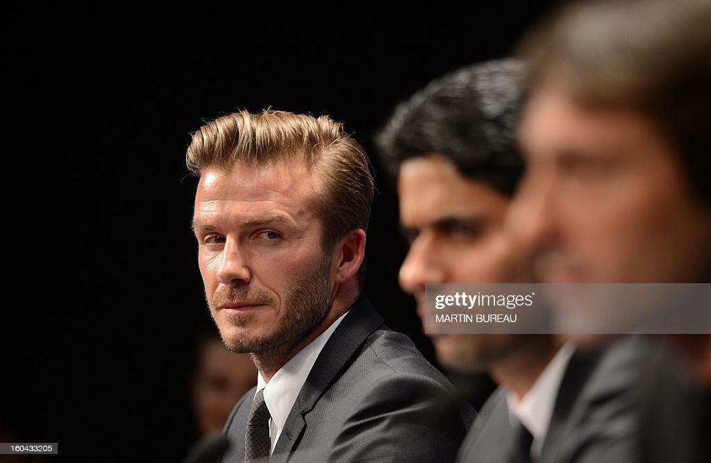 British football player David Beckham (L) gives a press conference flanked by PSG Qatari president Nasser Al-Khelaifi (C) and Brazilian sport director Leonardo on January 31, 2013 at the Parc des Princes stadium in Paris. Beckham signed a five-month deal with the French Ligue 1 football club Paris Saint Germain until the end of June.