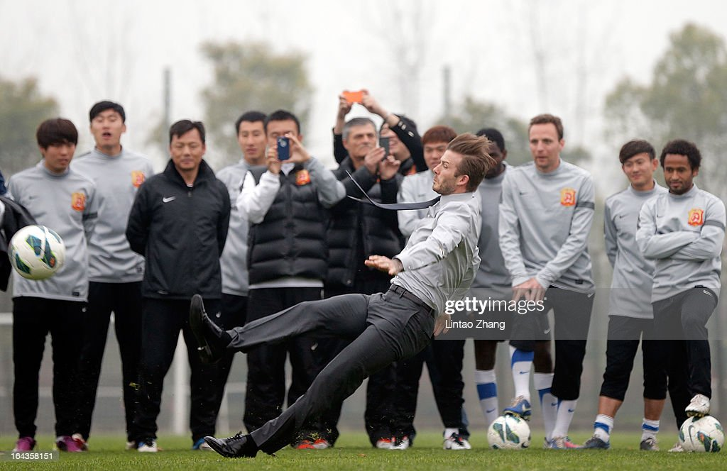 British football player <a gi-track='captionPersonalityLinkClicked' href=/galleries/search?phrase=David+Beckham&family=editorial&specificpeople=158480 ng-click='$event.stopPropagation()'>David Beckham</a> kicks the ball during a visit to Wuhan Zall Football Club at Wuhan Hubei Province on March 23, 2013 in Wuhan, China. Beckham is on a five-day visit to China at the invitation of the China Football Association as China's first international ambassador.