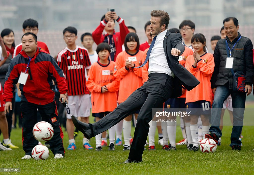 British football player David Beckham kicks the ball with the Youth Football Team at Hankou Literary and Sports Centeron March 23, 2013 in Wuhan, China. David Beckham is on a five-day visit to China at the invitation of the China Football Association as China's first international ambassador.