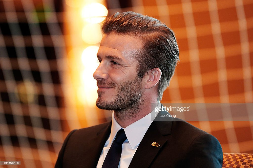 British football player David Beckham looks on during his meets Fans at China World Trade Center Tower 3 on March 24, 2013 in Beijing, China. David Beckham is on a five-day visit to China at the invitation of the China Football Association as China's first international ambassador.