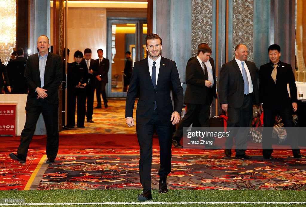 British football player David Beckham meets fans at China World Trade Center Tower 3 on March 24, 2013 in Beijing, China. David Beckham is on a five-day visit to China at the invitation of the China Football Association as China's first international ambassador.