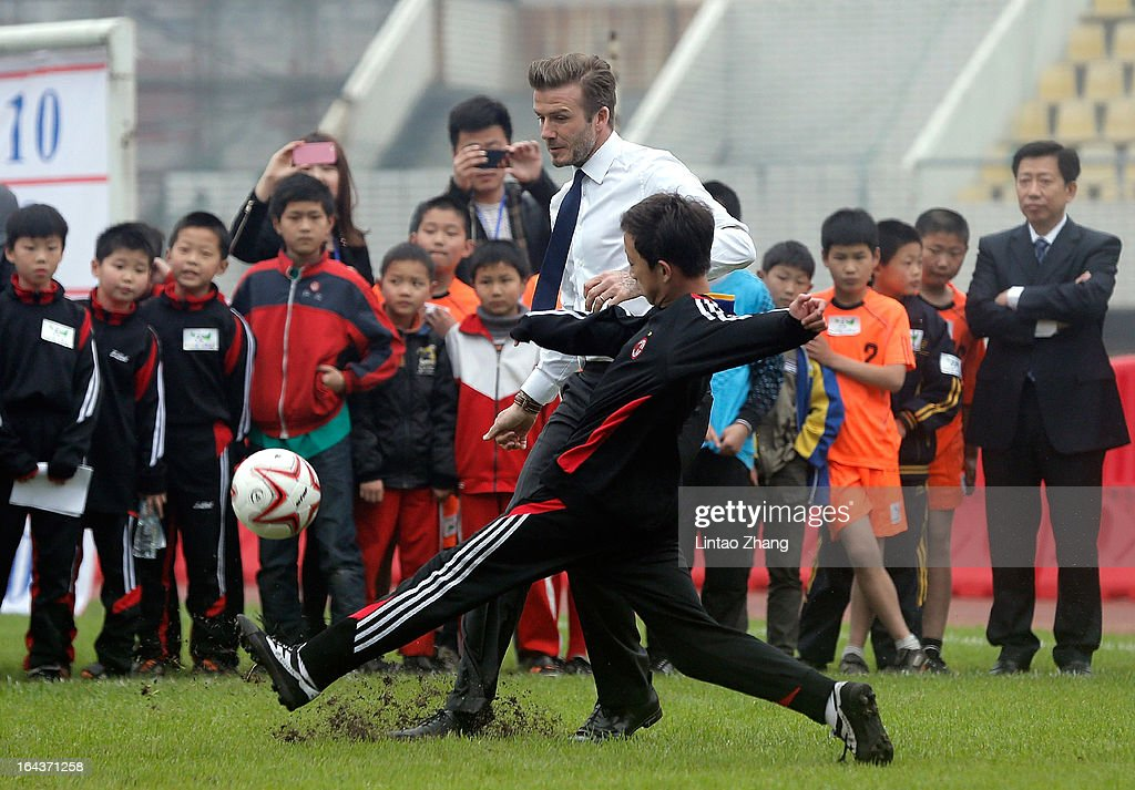 British football player <a gi-track='captionPersonalityLinkClicked' href=/galleries/search?phrase=David+Beckham&family=editorial&specificpeople=158480 ng-click='$event.stopPropagation()'>David Beckham</a> plays football with the youth team at Hankou Literary and Sports Centeron March 23, 2013 in Wuhan, China. <a gi-track='captionPersonalityLinkClicked' href=/galleries/search?phrase=David+Beckham&family=editorial&specificpeople=158480 ng-click='$event.stopPropagation()'>David Beckham</a> is on a five-day visit to China at the invitation of the China Football Association as China's first international ambassador.