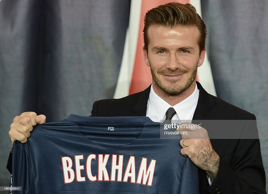 British football player David Beckham poses presenting his new jersey after a press conference on January 31, 2013 at the Parc des Princes stadium in Paris. Beckham signed a five-month deal with the French Ligue 1 football club Paris Saint Germain until the end of June.