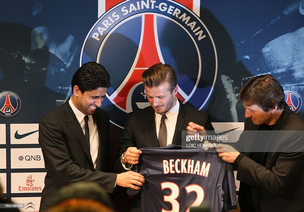 British football player David Beckham (C) poses presenting his new jersey flanked by PSG Qatari president Nasser Al-Khelaifi (L) and PSG sports director Leonardo during a press conference on January 31, 2013 at the Parc des Princes stadium in Paris. Beckham signed a five-month deal with the French Ligue 1 football club Paris Saint Germain until the end of June.