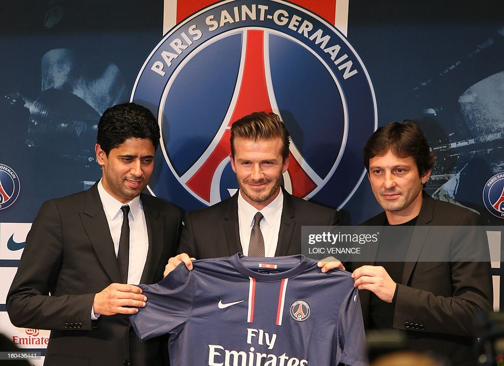 British football player David Beckham (C) poses presenting his new jersey flanked by PSG Qatari president Nasser Al-Khelaifi (L) and PSG sports director Leonardo during a press conference on January 31, 2013 at the Parc des Princes stadium in Paris. Beckham signed a five-month deal with the French Ligue 1 football club Paris Saint Germain until the end of June. AFP PHOTO / LOIC VENANCE