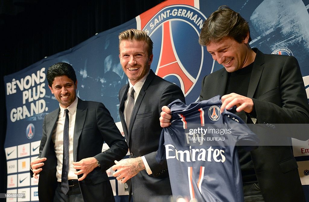 British football player David Beckham (C) poses with his new jersey flanked by PSG Qatari president Nasser Al-Khelaifi (L) and PSG Brazilian sport director Leonardo during a press conference on January 31, 2013 at the Parc des Princes stadium in Paris. Beckham signed a five-month deal with the Ligue 1 leader until the end of June.