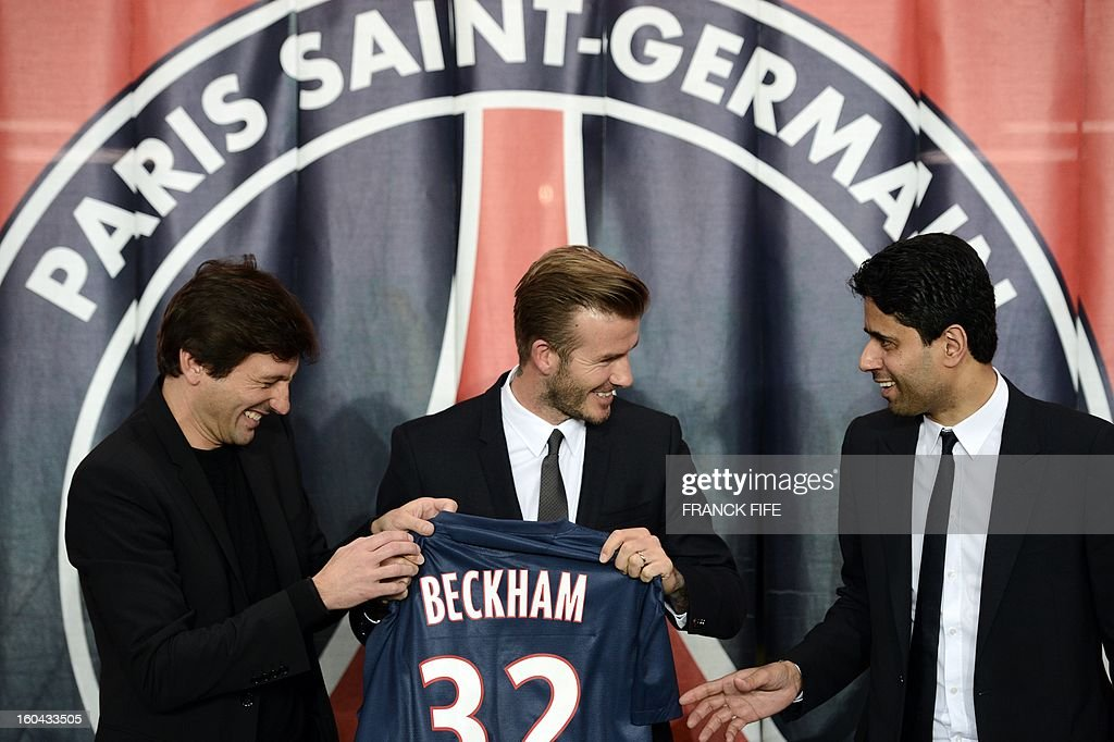 British football player David Beckham (C) poses with his new jersey flanked by PSG Qatari president Nasser Al-Khelaifi (R) and PSG sports director Leonardo after a press conference on January 31, 2013 at the Parc des Princes stadium in Paris. Beckham signed a five-month deal with the French Ligue 1 football club Paris Saint Germain until the end of June.