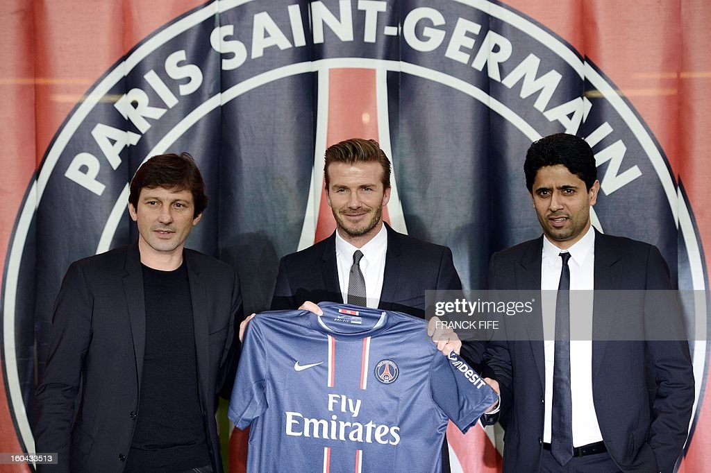 British football player David Beckham (C) poses with his new jersey flanked by PSG Qatari president Nasser Al-Khelaifi (R) and PSG sports director Leonardo after a press conference on January 31, 2013 at the Parc des Princes stadium in Paris. Beckham signed a five-month deal with the French Ligue 1 football club Paris Saint Germain until the end of June. AFP PHOTO / FRANCK FIFE