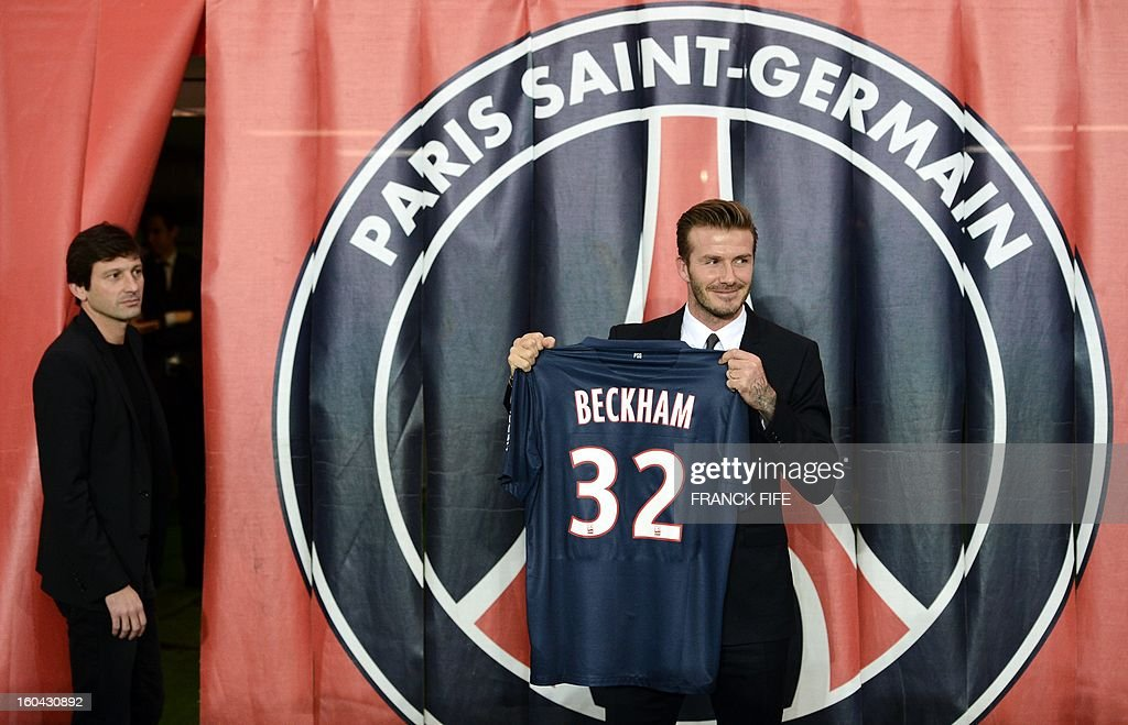 British football player David Beckham poses with his new Paris Saint-Germain (PSG) jersey at the end of a press conference, on January 31, 2013 at the Parc des Princes stadium in Paris. Beckham signed a five-month deal with the Ligue 1 leader until the end of June.