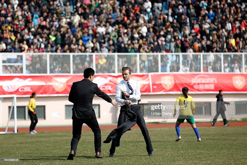 British football player <a gi-track='captionPersonalityLinkClicked' href=/galleries/search?phrase=David+Beckham&family=editorial&specificpeople=158480 ng-click='$event.stopPropagation()'>David Beckham</a> prepares to play football with the Qingdao youth team at Tiantai Stadium, Shandong Province on March 22, 2013 in Qingdao, China. <a gi-track='captionPersonalityLinkClicked' href=/galleries/search?phrase=David+Beckham&family=editorial&specificpeople=158480 ng-click='$event.stopPropagation()'>David Beckham</a> is on a five-day visit to China at the invitation of the China Football Association as China's first international ambassador.