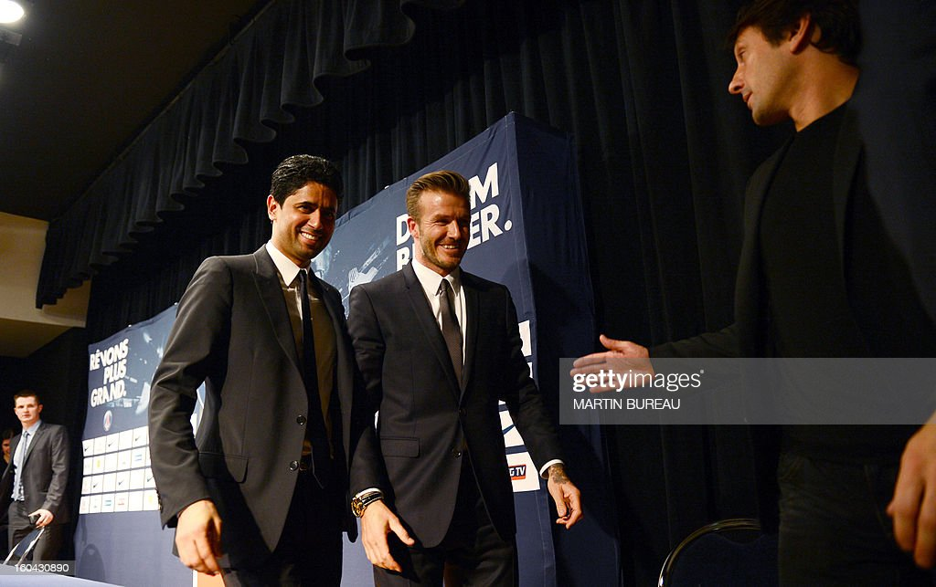 British football player David Beckham (C), PSG Qatari president Nasser Al-Khelaifi (L) and Brazilian sport director Leonardo (R) leave a press conference on January 31, 2013 at the Parc des Princes stadium in Paris. Beckham signed a five-month deal with the Ligue 1 leader until the end of June.