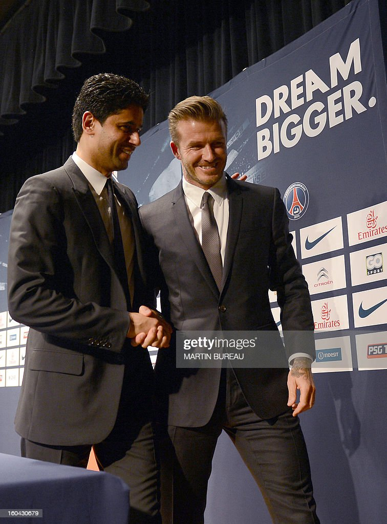 British football player David Beckham (R) shakes hand with PSG Qatari president Nasser Al-Khelaifi (L) as they leave a press conference, on January 31, 2013 at the Parc des Princes stadium in Paris. Beckham signed a five-month deal with the Ligue 1 leader until the end of June.