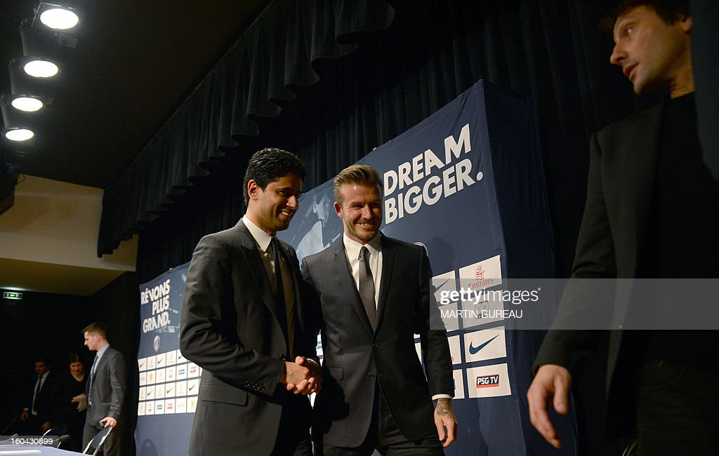 British football player David Beckham (C) shakes hand with PSG Qatari president Nasser Al-Khelaifi (L) as they leave a press conference with Brazilian sport director Leonardo (R), on January 31, 2013 at the Parc des Princes stadium in Paris. Beckham signed a five-month deal with the Ligue 1 leader until the end of June.