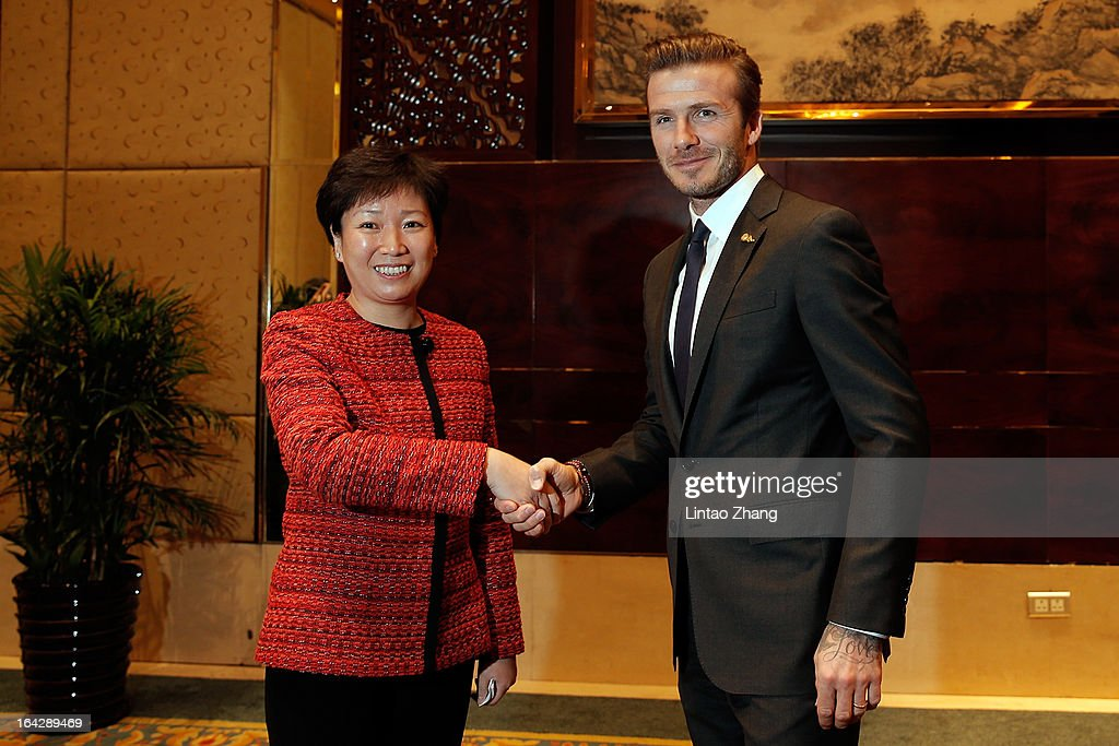 British football player <a gi-track='captionPersonalityLinkClicked' href=/galleries/search?phrase=David+Beckham&family=editorial&specificpeople=158480 ng-click='$event.stopPropagation()'>David Beckham</a> shakes hands with Vice Mayor of Qingdao Luan Xin at Shangri-La Hotel at Qingdao Shandong Province on March 22, 2013 in Qingdao, China. <a gi-track='captionPersonalityLinkClicked' href=/galleries/search?phrase=David+Beckham&family=editorial&specificpeople=158480 ng-click='$event.stopPropagation()'>David Beckham</a> is on a five-day visit to China at the invitation of the China Football Association as China's first international ambassador.