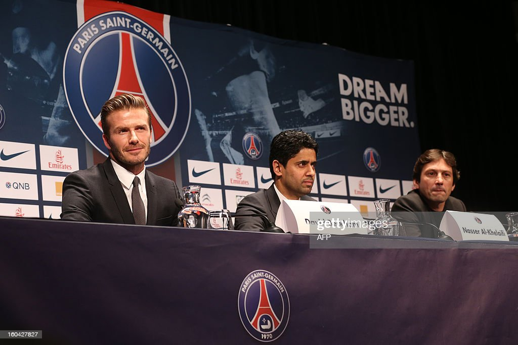 British football player David Beckham (L) smiles next to PSG's Qatari president Nasser Al-Khelaifi (C) and Brazilian sport director Leonardo during a press conference at the Parc des Princes stadium in Paris on January 31, 2013 to announce that he joined the French ligue 1 football club Paris Saint-Germain (PSG).