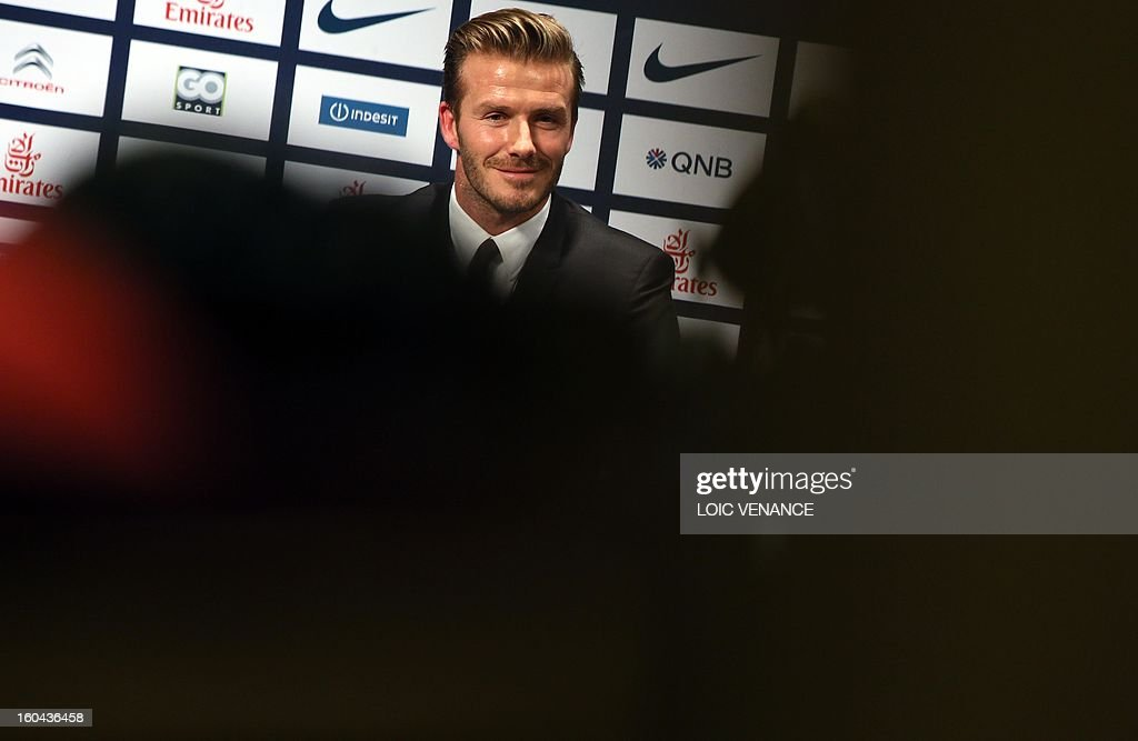 British football player David Beckham takes part in a press conference on January 31, 2013 at the Parc des Princes stadium in Paris. Beckham signed a five-month deal with the French Ligue 1 football club Paris Saint Germain until the end of June. AFP PHOTO / LOIC VENANCE