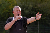 A football referee blowing his whistle.