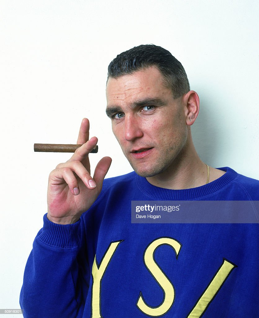 British footballer and actor Vinnie Jones with a large cigar, 1998.