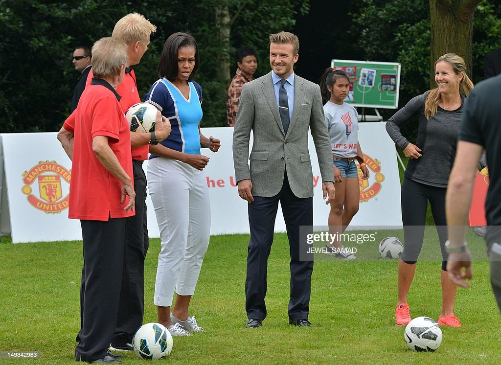 British footballer <a gi-track='captionPersonalityLinkClicked' href=/galleries/search?phrase=David+Beckham&family=editorial&specificpeople=158480 ng-click='$event.stopPropagation()'>David Beckham</a> (2ndR) and US First Lady <a gi-track='captionPersonalityLinkClicked' href=/galleries/search?phrase=Michelle+Obama&family=editorial&specificpeople=2528864 ng-click='$event.stopPropagation()'>Michelle Obama</a> (3rdL) take part in a 'Let's Move-London' event at the Winfield House in London on July 27, 2012, hours before the start of the London 2012 Olympic Games. AFP PHOTO/ JEWEL SAMAD