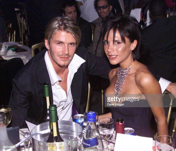 British footballer David Beckham and wife pop star Victoria Beckham attend the MOBO Awards at the Royal Albert Hall on October 6 1999 in London