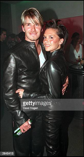 British footballer David Beckham and wife Victoria Beckham attend the Versace Store opening party on New Bond Street on June 11 1999 in London