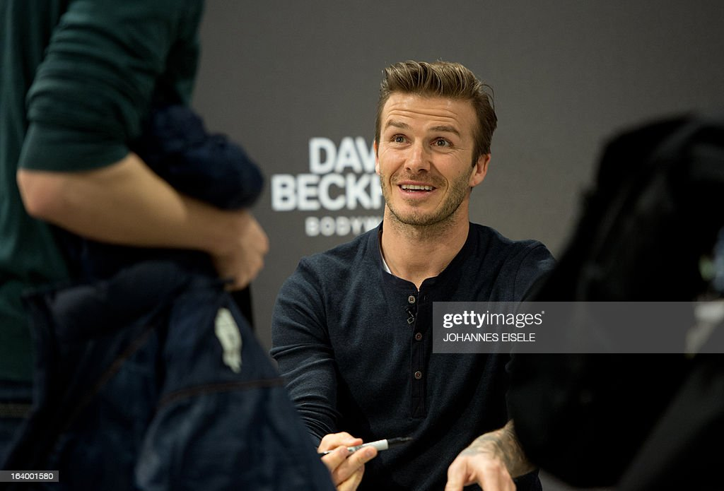 British footballer David Beckham attends on March 19, 2013 a commercial assignment at H&M store in Berlin.