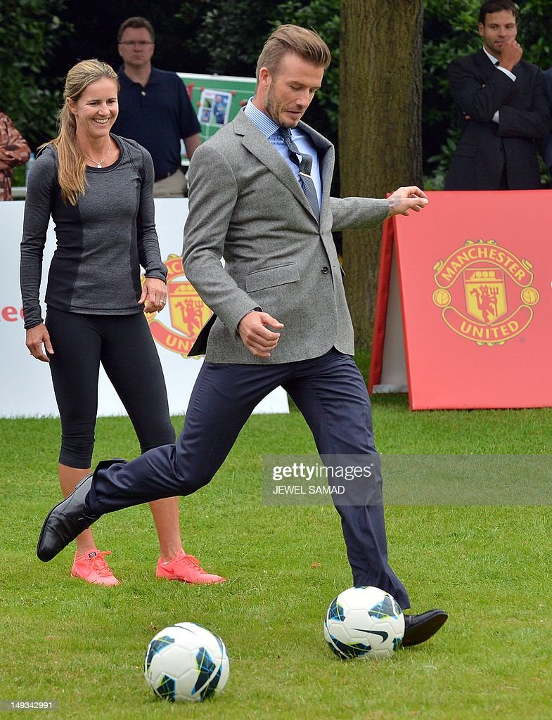 British footballer David Beckham kicks the ball during US First Lady Michelle Obama's 'Let's Move-London' event at the Winfield House in London on July 27, 2012, hours before the start of the London 2012 Olympic Games. AFP PHOTO/ JEWEL SAMAD