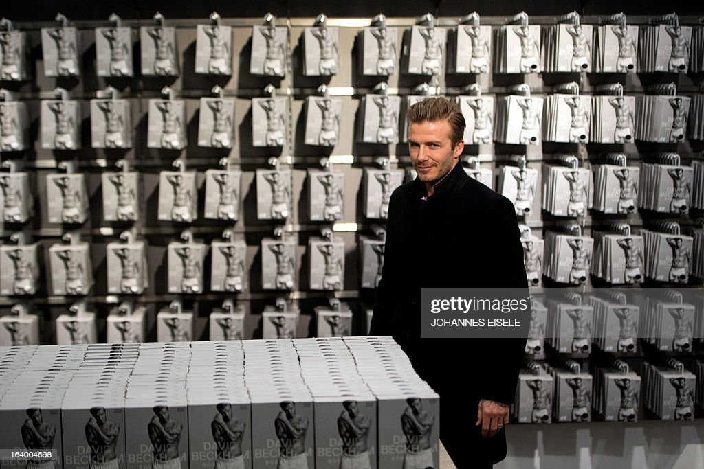 British footballer David Beckham poses on March 19, 2013 during a commercial assignment at H&M store in Berlin. AFP PHOTO / JOHANNES EISELE