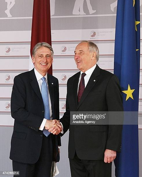 British Foreign Minister Philip Hammond is welcomed by Latvian President Andris Berzins as he arrives at the House of the Blackhead for a dinner at...