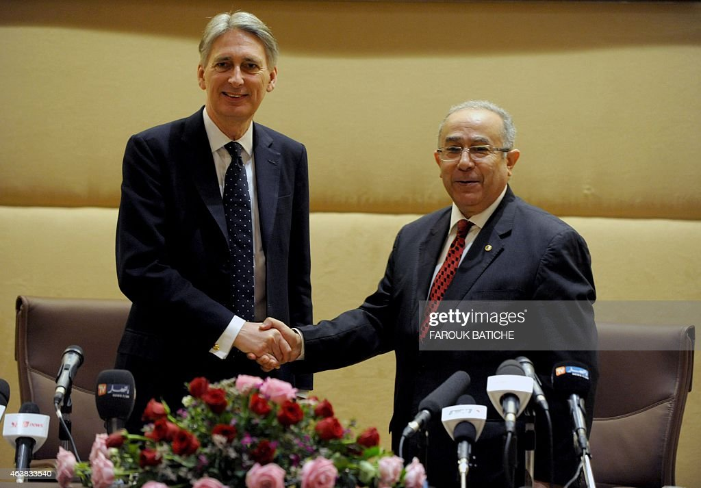 British foreign minister <a gi-track='captionPersonalityLinkClicked' href=/galleries/search?phrase=Philip+Hammond&family=editorial&specificpeople=2486715 ng-click='$event.stopPropagation()'>Philip Hammond</a> shakes hands with Algerian foreign minister <a gi-track='captionPersonalityLinkClicked' href=/galleries/search?phrase=Ramtane+Lamamra&family=editorial&specificpeople=5486120 ng-click='$event.stopPropagation()'>Ramtane Lamamra</a> (R) during a joint press conference following a meeting on February 19, 2015 in Algiers. Hammond said there is a 'convergence of views' between the two countries on the conflict in Libya. AFP PHOTO / FAROUK BATICHE