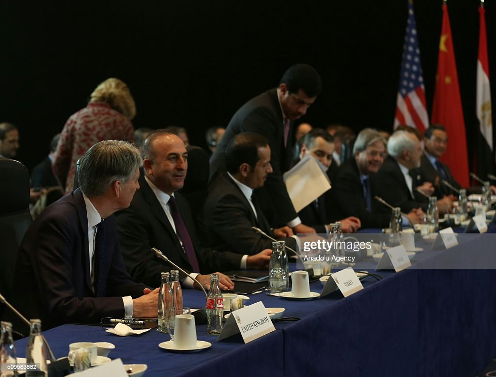 British Foreign Minister Philip Hammond (L), Turkish Foreign Minister Mevlut Cavusoglu (left 2) and Qatar's Foreign Minister Sheikh Mohammed bin Abdulrahman bin Jassim Al-Thani (left 3) attend the International Syrian Support Group Meeting in Munich, on February 11, 2016.