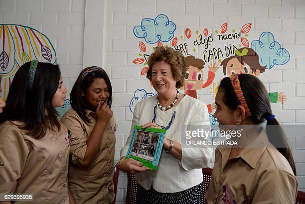 British Foreign Office's Minister of State Joyce Anelay speaks with students at the Jose Miguel Vasconcelos school in Guatemala City on December 12...