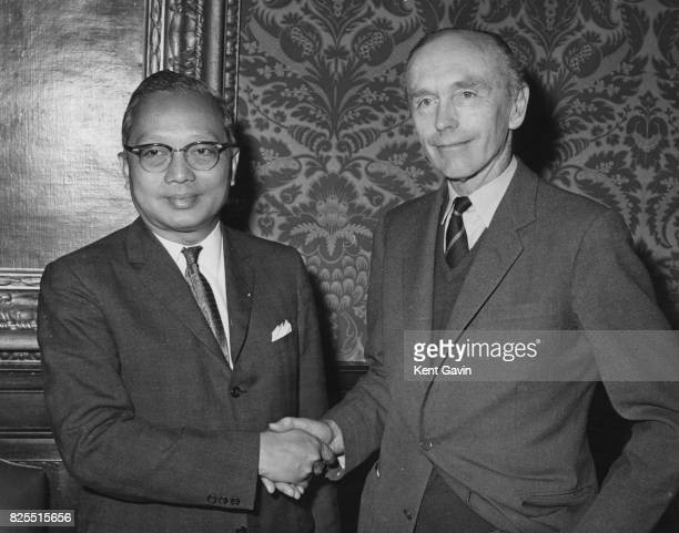 British Foreign Secretary Alec DouglasHome shakes hands with U Thant SecretaryGeneral of the United Nations at the Foreign Office in London 10th May...