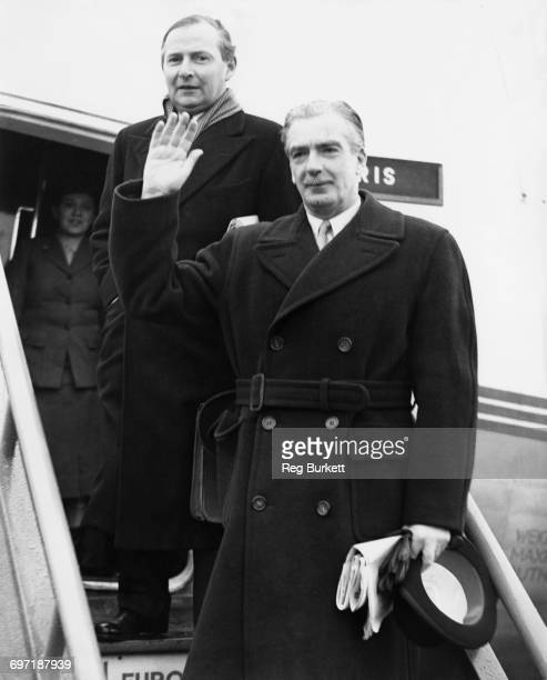 British Foreign Secretary Anthony Eden and Minister of State for Foreign Affairs Selwyn Lloyd boarding an aicraft at RAF Northolt on their way to...