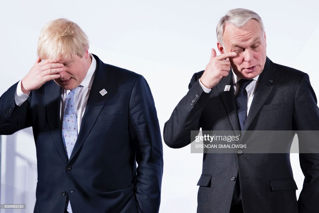 British Foreign Secretary Boris Johnson (L) and France's Foreign Minister Jean-Marc Ayrault wait for a group photo of G-20 foreign ministers during a meeting at the World Conference Center February 16, 2017 in Bonn, Germany. US Secretary of State Rex Tillerson makes his diplomatic debut at a G20 gathering in Germany on February 16, 2017 where his counterparts hope to find out what 'America First' means for the rest of the world. / AFP / Brendan Smialowski