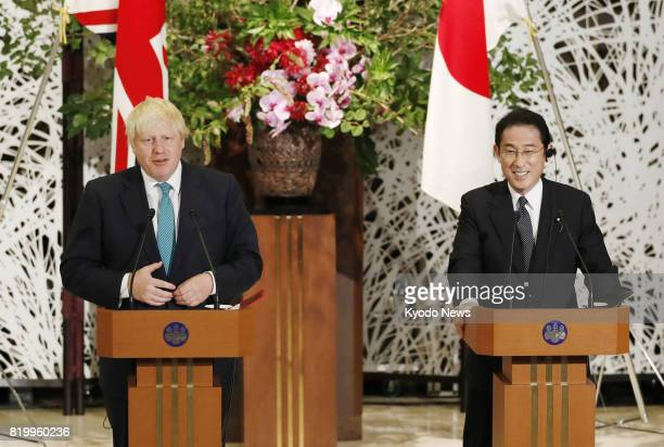 British Foreign Secretary Boris Johnson and his Japanese counterpart Fumio Kishida hold a joint press conference in Tokyo on July 21 after discussing...