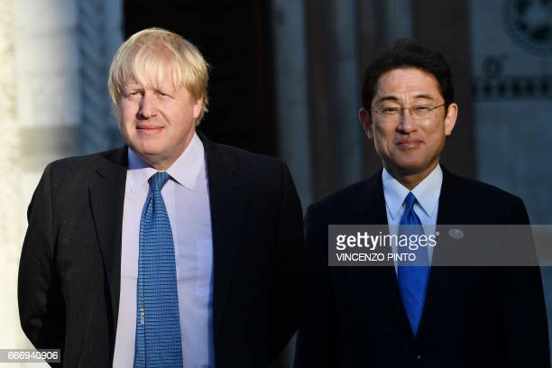 British Foreign Secretary Boris Johnson and Japanese Foreign Minister Fumio Kishida take their position for a family picture during a meeting of...