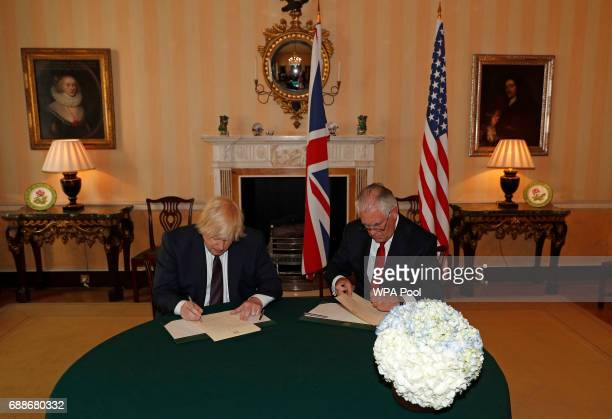 British Foreign Secretary Boris Johnson and US secretary of state Rex Tillerson write messages of condolence inside Carlton Gardens in London England...