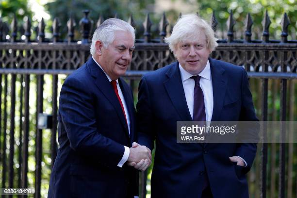 British Foreign Secretary Boris Johnson greets US secretary of state Rex Tillerson outside Carlton Gardens on May 26 2017 in London England Rex...