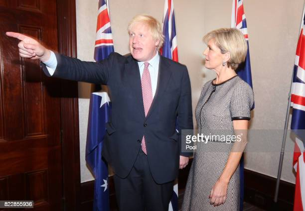 British Foreign Secretary Boris Johnson points after arriving with Australian Foreign Minister Julie Bishop to they begin their bilateral meeting in...
