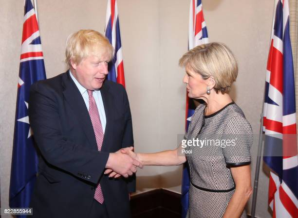British Foreign Secretary Boris Johnson shakes hands with Australian Foreign Minister Julie Bishop as they arrive for their bilateral meeting in...